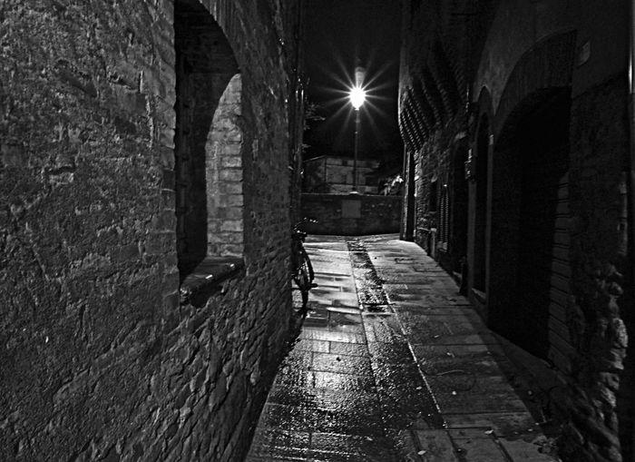 Illuminated walkway at night