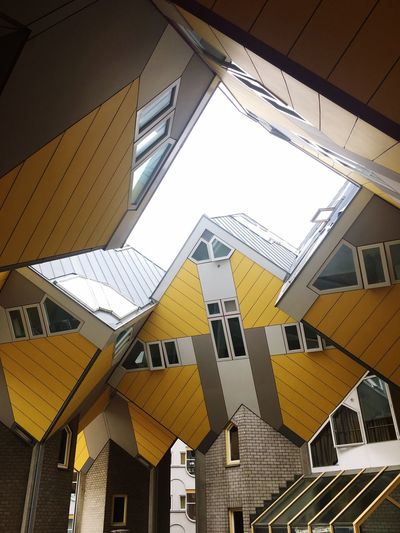 Built Structure Architecture Low Angle View Building Exterior Building Day No People Window Yellow Residential District Pattern Directly Below Clear Sky City Sunlight Nature Ceiling Roof Sky Outdoors