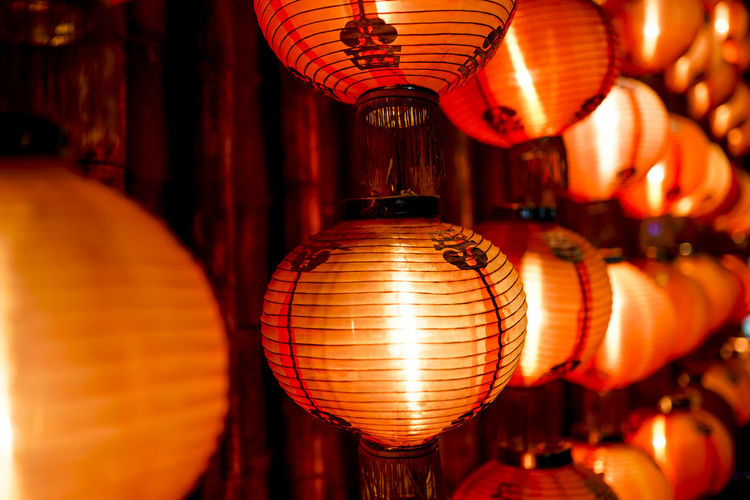 Chinese lantern close up Lighting Equipment Illuminated Decoration Hanging Lantern Chinese Lantern No People Indoors  Orange Color In A Row Belief Celebration Focus On Foreground Red Repetition Night Large Group Of Objects Religion Electric Lamp Light Paper Lantern Chinese Lantern Festival