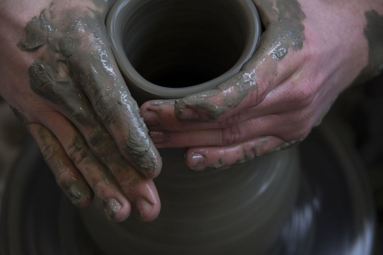 Close-Up Of Hands Making Pot