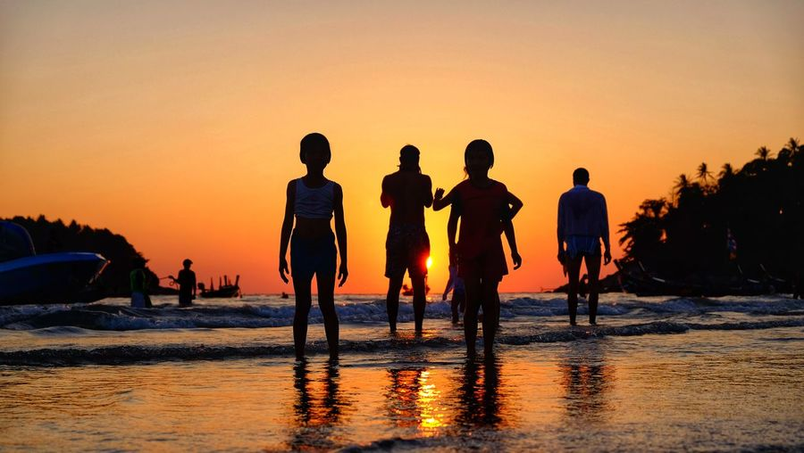 Sunset Silhouette Sand People Vacations Fun Beach Water Sky Travel Boat Sun Togetherness Full Length Summer Holiday Tourist Season  Day Passing Time Reflection Happiness Enjoying Life Livestyle