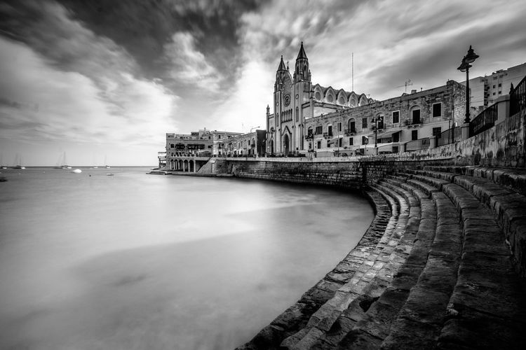 A long exposure of the St. Julien Bay, Malta Architecture Sky Built Structure Building Exterior Cloud - Sky History Nature The Past Water Travel Destinations Building Travel No People Tourism City Day Sea Outdoors Church Church Architecture Ocean Cloud Long Exposure Anfiteatro Stairs