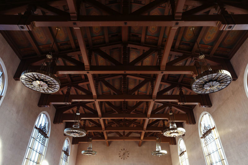 Architecture Built Structure Ceiling Chandeliers Day Geometry Hanging Historic Indoors  Low Angle View Natural Light No People Side Light Wooden Beams