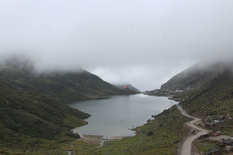 Tsongpo Lake, Sikkim Beauty In Nature Day Fog Grass Landscape Mountain Nature No People Outdoors Physical Geography Scenics Sky Tranquil Scene Tranquility Water