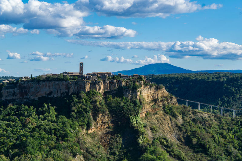 Civita di Bagnoregio, Italy is the perfect hll top town. Ancient, romantic, isolated. Civita Di Bagnoregio Architecture Beauty In Nature Building Exterior Built Structure Cloud - Sky Day Landscape Mountain Nature No People Outdoors Scenics Sky Travel Destinations Tree An Eye For Travel