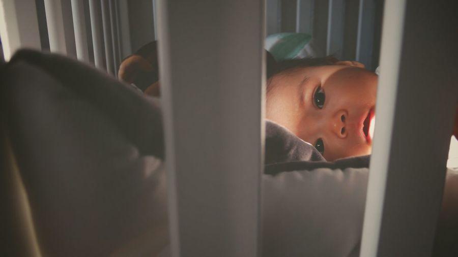 Portrait Of Baby In Crib