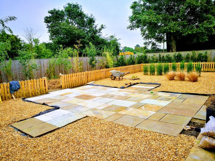 Skilled Landscaping Landscaping Patio Colourful Patio Colourful Paving Indian Sandstone River Washed Golden Gravel Neat Garden Garden Design Minimalist Garden Design Tree Sky Blooming