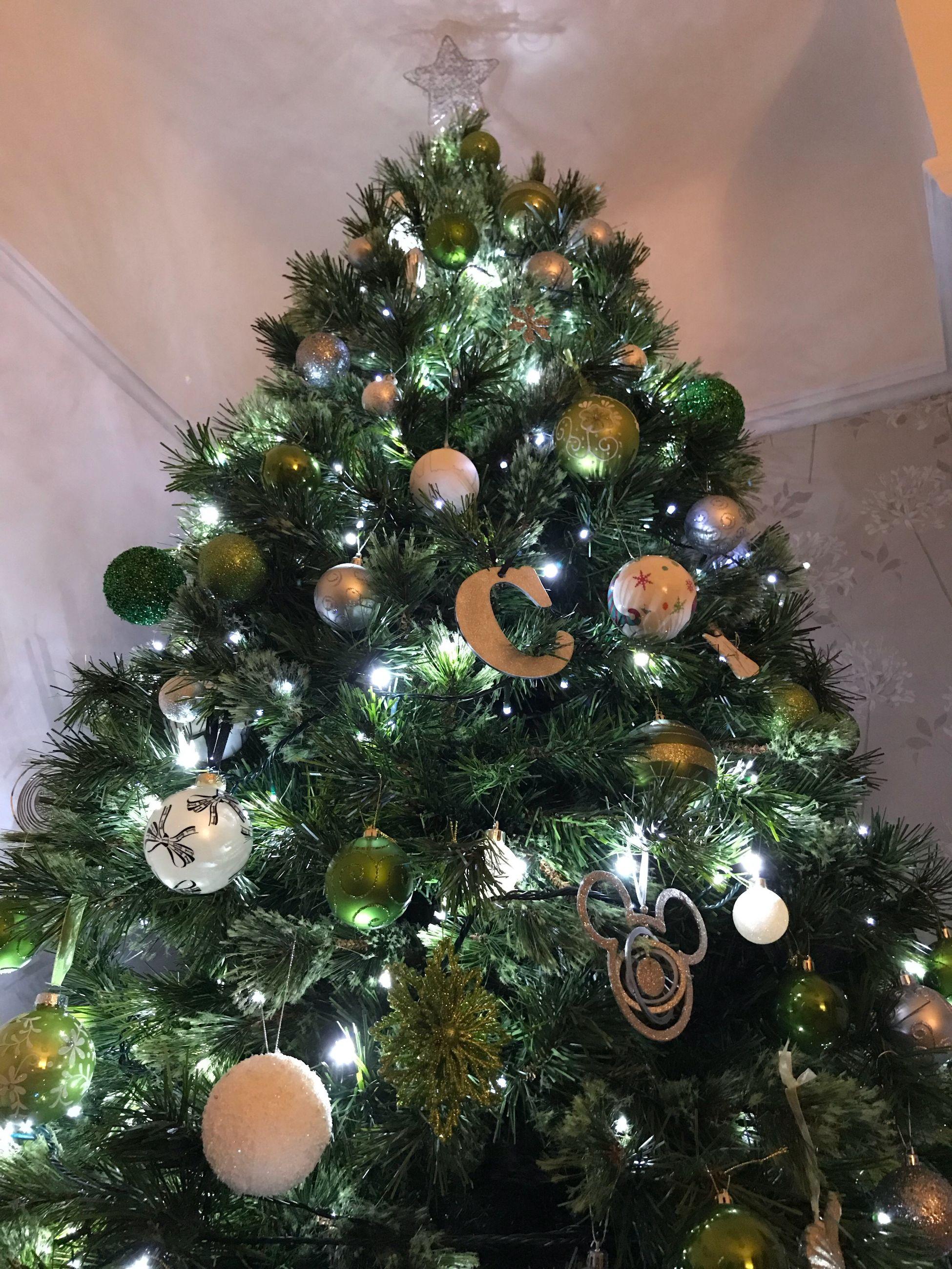 christmas, christmas tree, celebration, christmas decoration, tradition, christmas ornament, decoration, indoors, christmas bauble, celebration event, holiday - event, bauble, cultures, christmas lights, home interior, green color, no people, vacations, tree, close-up, illuminated, day