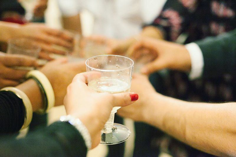 GROUP OF PEOPLE HOLDING CHAMPAGNE GLASSES