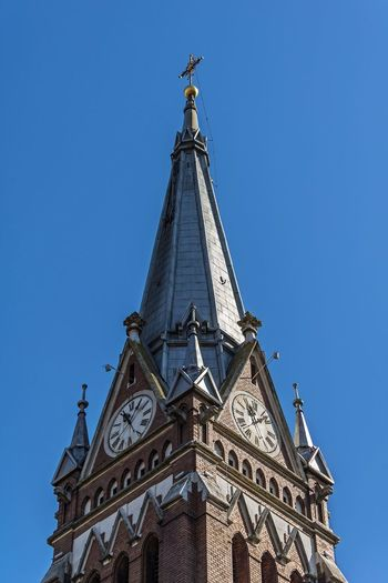 Low angle view of traditional building against clear blue sky
