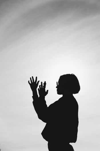 Silhouette Bw Blackandwhite Sky Gesturing Person Cloud - Sky Sky And Clouds Background Sunshine Direct Light Exposure Monochrome Photography
