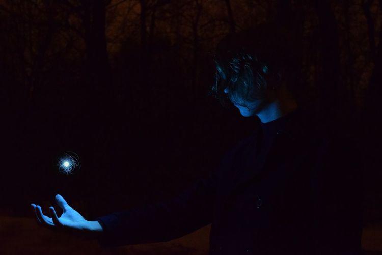 Full length portrait of man standing at night