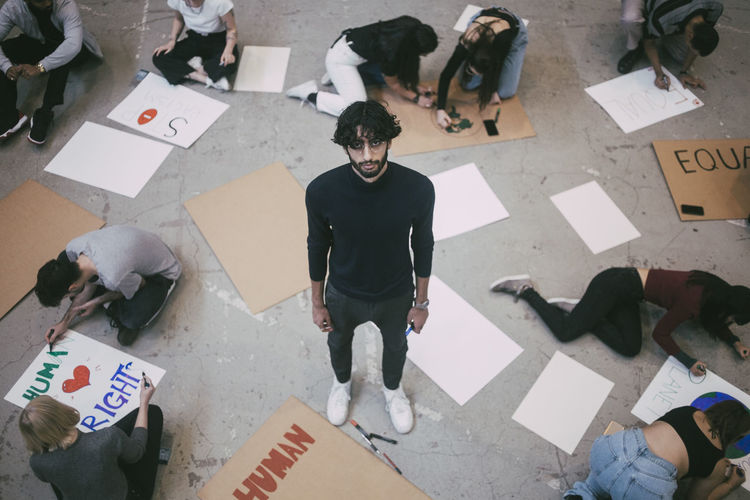 High angle view of people standing on floor