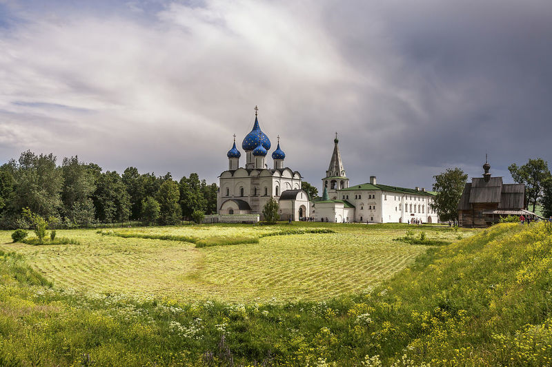 Architecture Building Exterior Built Structure Church Cloud Cloud - Sky Cloudy Field Grass Green Color Growth Lawn Nature Place Of Worship Plant Religion Russia Sky Spirituality Suzdal Kremlin Tree