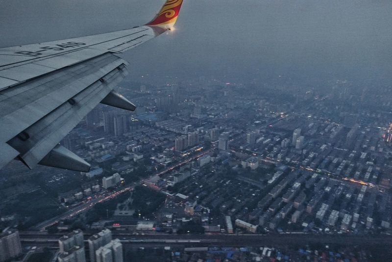 China Photos Approaching Airport Wing Airplane Aerial View Transportation Flying Travel Sky No People Mode Of Transport Air Vehicle Outdoors Cityscape Day Above Urban Skyline Building Exterior Architecture Built Structure Night Lights Tianjin Airlines From An Airplane Window Streamzoofamily