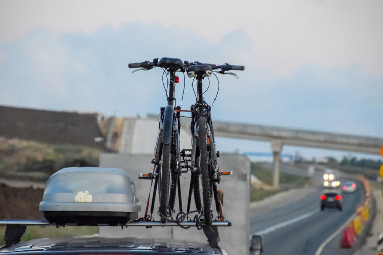 Close-up of bicycle on road against sky