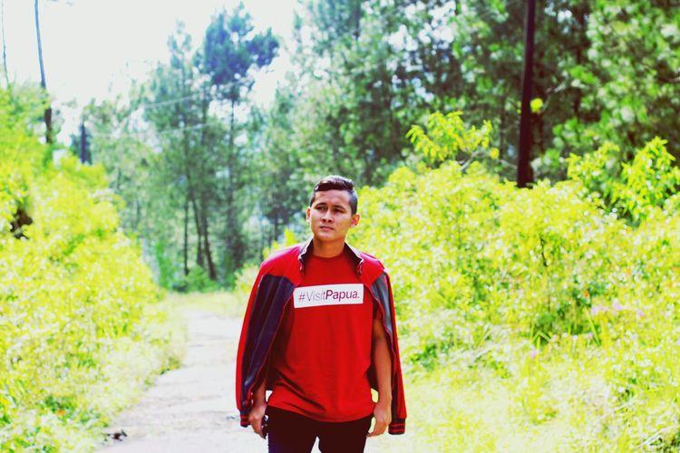 Portrait of man standing on dirt road
