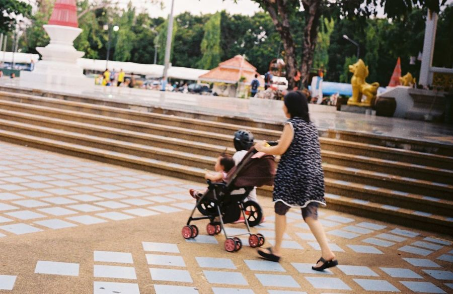 Adult Adults Only Baby Stroller Bicycle Bonding Childhood Daughter Day Family With One Child Father Full Length Leisure Activity Lifestyles Mother Outdoors People Playing Real People The Street Photographer - 2017 EyeEm Awards Togetherness Walking