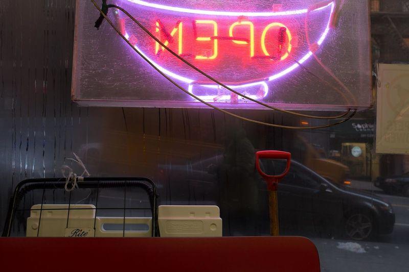 Illuminated text on bus stop