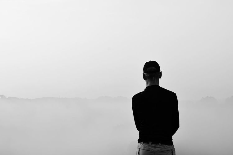 man looking view of mountain sky in the morning time, black and white Change Season  View Outdoors Man Lifestyles Blackandwhite Enjoy Standing People person One Person Copy Space Men Silhouette Standing Rear View Foggy Fog Back Smog Air Pollution Backache