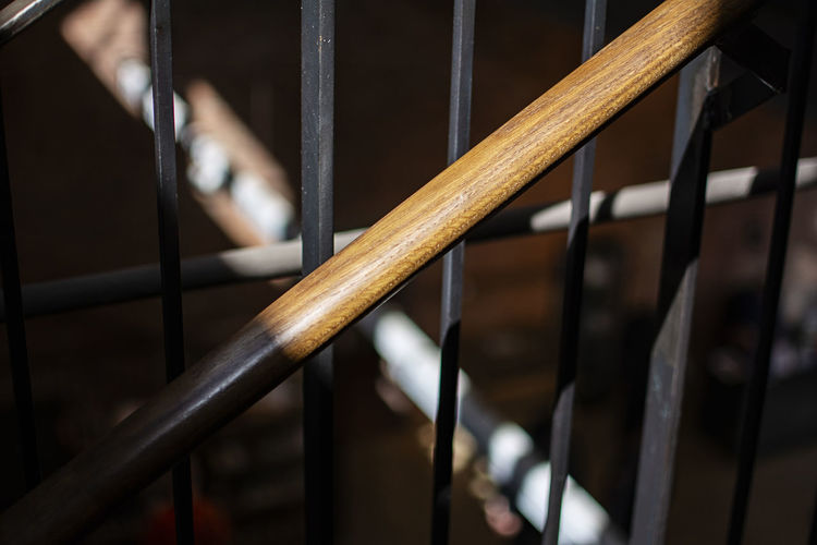 Close-up of metal railing in building