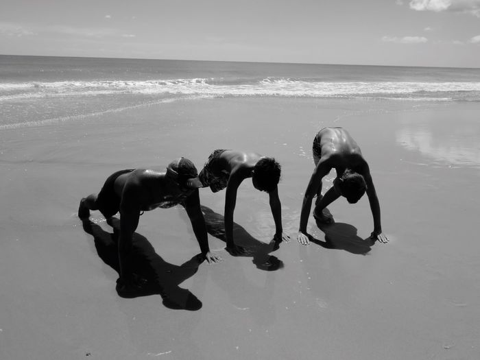 A Marine Dad sharing 22 Push-ups With His Sons. JustGPhotos Topsail Island, NC Dads And Sons Mentalhealth  Mental Illness Marine Fatherhood Moments The Magic Mission Horizon Over Water Beach Sea Wave Animal Themes Dog Water Shore Domestic Animals Tranquil Scene Seascape Zoology Vacations Scenics Tranquility Non-urban Scene Coastline