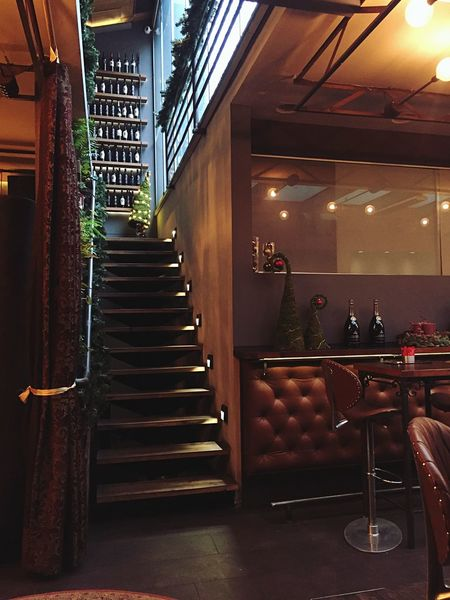 Indoor Photography Indoors  Illuminated Staircase Architecture Luxury Architectural Column Built Structure City Steps And Staircases No People Pew Wine Wine Bottles Wine Shop Enjoying Life Enjoying The View Places Caffè Croatia Indoors