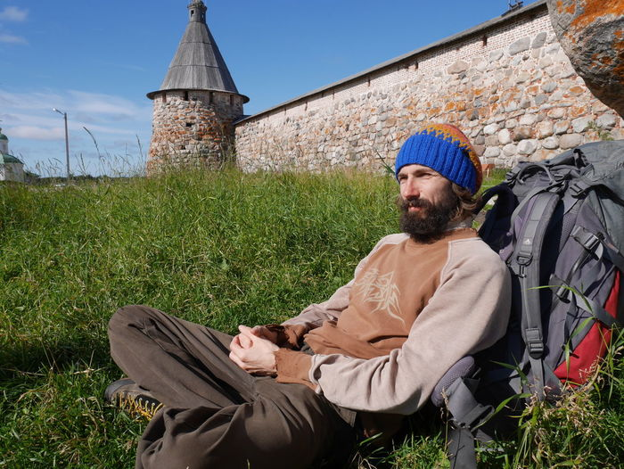 Church Monastery Ancient Architecture Tower Portrait Man Beard Beard Man Travelling Day Grass Relax Rest Solovki Solovetskie Ostrova Sit Wood Wall Christianity Christian Religion Hike Hiker Bagpack