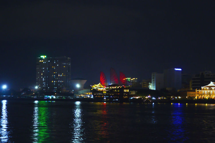 Architecture Building Exterior At Night In Vietnam. Vietnam Architecture Building Building Exterior Built Structure City Cityscape Financial District  Illuminated Landscape Modern Nature Night Nightlife No People Office Building Exterior Outdoors Reflection River Sky Skyscraper Travel Destinations Urban Skyline Water Waterfront