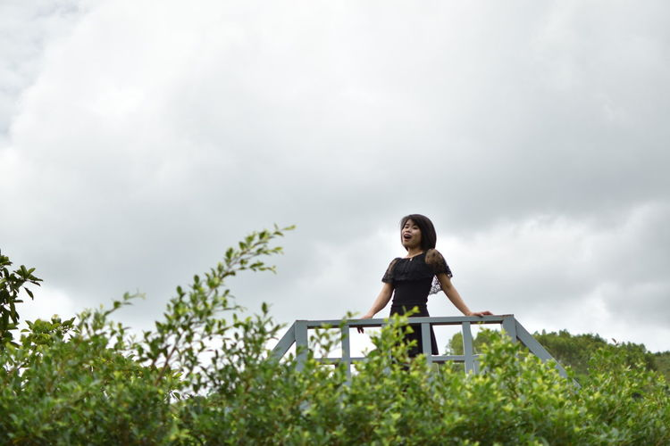 Adult Casual Clothing Cloud - Sky Contemplation Day Front View Full Length Low Angle View Nature One Person Outdoors Plant Sky Standing Tree Women Young Adult Young Women