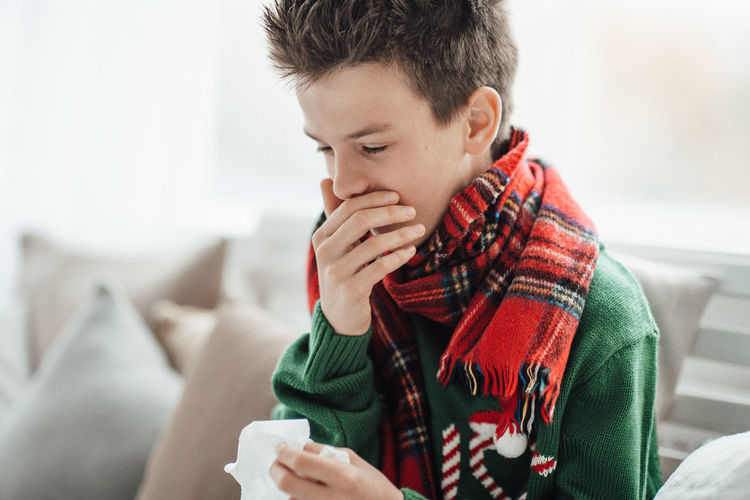 Close-up of boy holding coffee cup