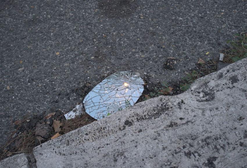 broken mirror on street with light reflections. Abandoned Broken Broken Mirror Dirty Geometry Light Light Reflection Mirror No People Outdoors Reflections Rough Sidewalk Street Urban