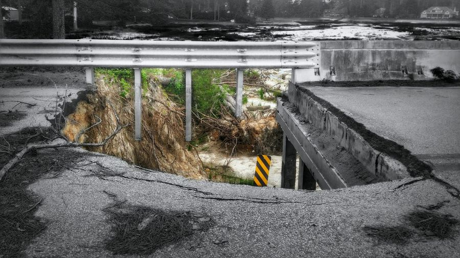 Aftermath of the Flood, Part 7: A Dam Shame (in Colorsplash and HDR) -- closer look at the GIANT hole that is STILL unrepaired on this road more than 6 months after the dams failed as a result of the historic flooding in October. Please visit my site to view more of this ongoing project @ http://elle.d6collab.com/portfolio/aftermath-of-the-flood/. I'll be adding more to it this weekend. You can browse the current list of my portfolio projects @ http://elle.d6collab.com/portfolio/ if you like. Would you like your own portfolio site designed by me and hosted on http://d6collab.com for free? With it, you can easily display photo galleries, post portfolio projects, accept donations for your projects, and even sell your own digital downloads! Please see this special donor gift if you're interested in having your own online portfolio that is monetizable right out-of-the-box: http://elle.d6collab.com/portfolio-subsites/! As a special bonus, in addition to your website, you will also be allowed exclusive early entry into the d6 Collab community! And for a limited time, you will also be guaranteed a FREE LIFETIME membership @ http://d6collab.com/! Please feel free to let me know if you have any questions or comments. You can see another angle on this, not in hdr or colorsplash, on my new account: @simplepoetography. Please follow along there as well, for hdr-free shots. ☺✌ Up Close Street Photography Hdr_Collection Coloursplash Street Streetphotography Street Photography Streetphoto_bw Road Hole In The Road Blackandwhite Black And White Built Structure Flood Damage Dam Damaged Damage Power In Nature Trees Nature EyeEm Nature Lover EyeEm Best Edits EyeEm Best Shots The Photojournalist - 2016 EyeEm Awards