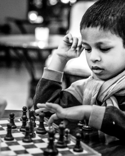 Playing chess in style! Black And White Boys Challenge Chess Chess Board Chess Piece Childhood Competition Day EyeEm EyeEm Best Edits EyeEm Best Shots EyeEm Gallery EyeEmPortraits Indoors  Intelligence Leisure Activity Leisure Games One Person Playing Queen - Chess Piece Real People Skill  Strategy Style