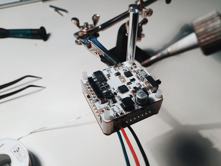 Working on my new hobby. Let's build a Quad250 Racing Drone. Deep technical shiat... but it feels like meditation. Building Cable Chip Desk DIY Quad Copter Racing Drone Repair Station Repairs Tech Hackers Technical Problems Technical Support Technology White Work