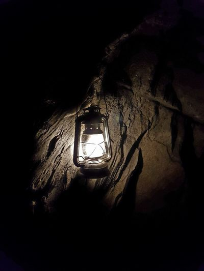 Lamp lit Dark No People Indoors  Low Angle View Day Cave Lamp Light Nofilter Notes From The Underground Undergroundphotography Caverns Light And Shadow Light In The Darkness