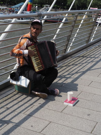 Music to my ears Day Hard Times Immigration Reform LONDON❤ Musician Old Father Thames Outdoors Portrait Sitting