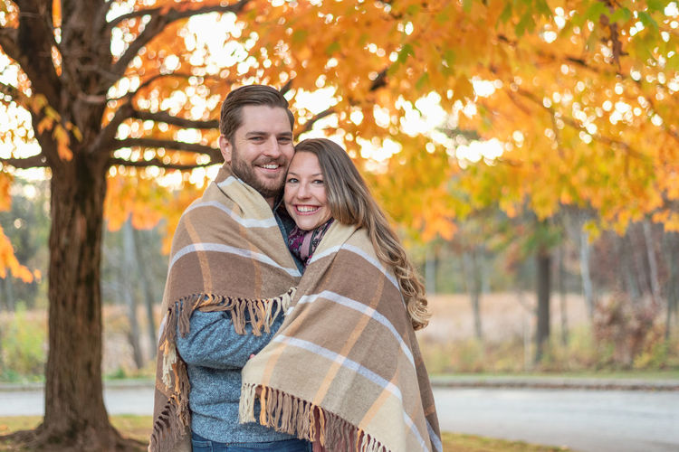 Portrait of a smiling young couple during autumn