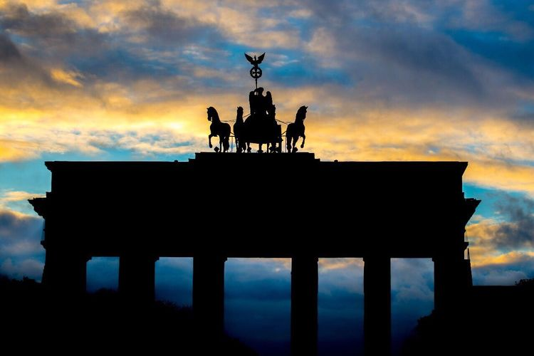 Brandenberg gate, the historical landmark of Berlin Cloud - Sky Statue Silhouette Built Structure City Gate Architectural Column No People