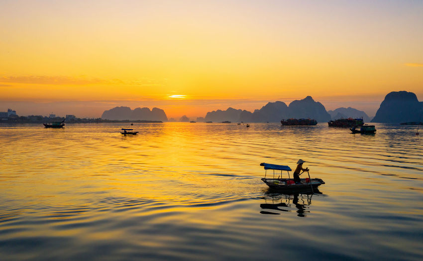 Sunset Water Sky Nautical Vessel Beauty In Nature Transportation Scenics - Nature Waterfront Orange Color Mode Of Transportation Tranquil Scene Tranquility Nature Idyllic Reflection Sea Non-urban Scene Silhouette Outdoors No People Floating On Water Bai Tu Long Bay Ha Long Bay Ha Long