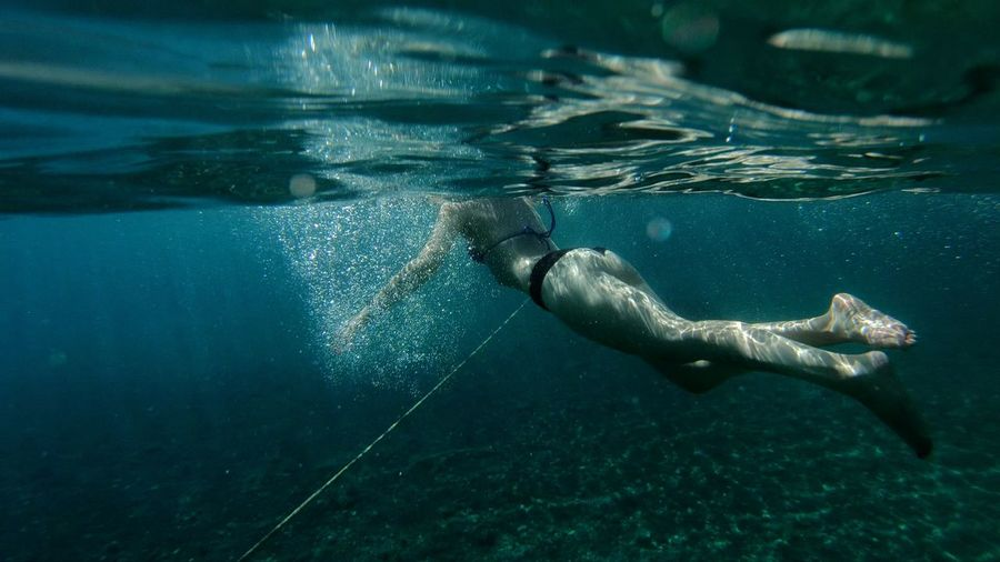 Full length of woman swimming in sea
