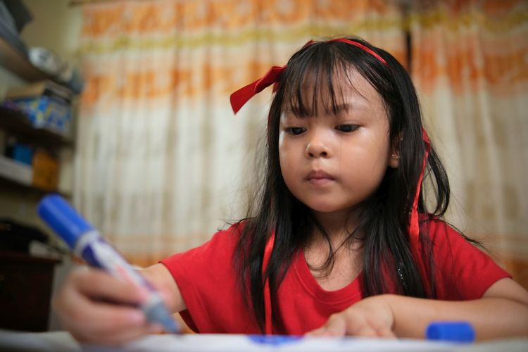 Kid studying at home during covid-19
