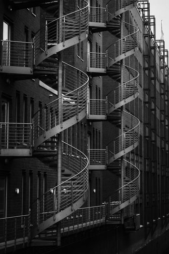 Spiral Staircase Architecture Black And White Building Building Exterior Built Structure City Emergency Exit Fire Escape Low Angle View Metal Nature No People Outdoors Railing Residential District Safety Speicherstadt Staircase Steps And Staircases Twins Urbanphotography Urgency Vintage