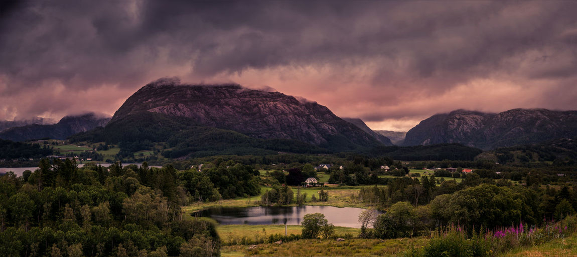 Norwegian mountains Mountain Cloud - Sky Sky Scenics - Nature Plant Beauty In Nature Nature No People Landscape Environment Water Mountain Range Tree Tranquility Tranquil Scene Storm Storm Cloud Land Overcast Outdoors Ominous