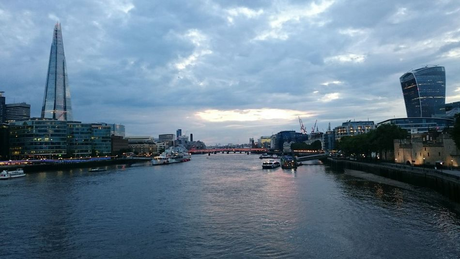 The Shard, River Thames in the middle then the Walkie Talkie building on the right on a perfect summer evening Architecture Evening Sky Cloud - Sky Riverside Water City Cityscapes Cityscape Sunset Waterfront River Thames Outdoors Tourism Travel Travel Destinations International Landmark Building Exterior Famous Place Capital Cities  No People EyeEm Gallery EyeEm Best Shots Eye4photography  Tall - High London Lifestyle EyeEm LOST IN London