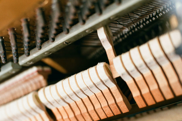 The internal structure of piano Construction Industrial Industry Iron Mechanical Music Piano Wood Brown Close-up Design Internal Metal Music Musical Instrument Musical Instrument String Object Steel Wood - Material