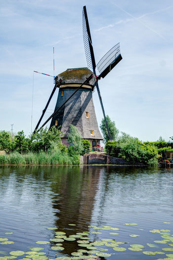 Nederland Alternative Energy Architecture Beauty In Nature Day Environmental Conservation Fuel And Power Generation Holland Holland❤ Industrial Windmill Kinderkdijk Lake Nature No People Outdoors Renewable Energy Sky Technology Traditional Windmill Tree Water Waterfront Wind Power Wind Turbine Windmill