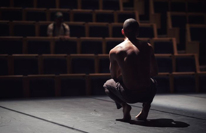 Dancers Sitting Full Length Men Young Adult Indoors  One Person Adult People Day Contemporary Dance Performance Dancing Dance Artists Theater Human Muscle The Human Body