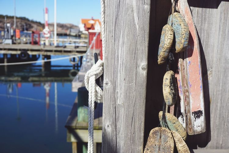 Close-up of wooden post at pier