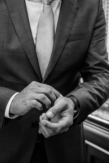 Midsection of businessman wearing watch